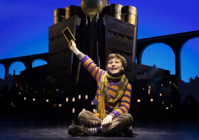 Young Charlie Bucket finds the last Golden Ticket